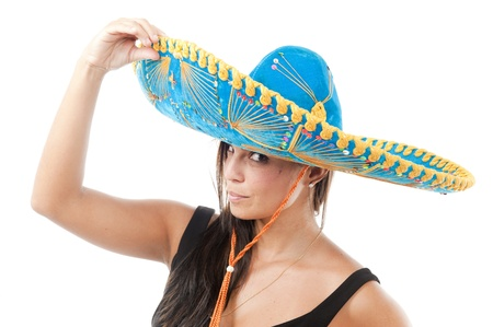 Studio shot of beautiful Girl with mexican hat .