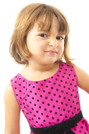 grimacing: Funny child girl grimacing on white background Stock Photo