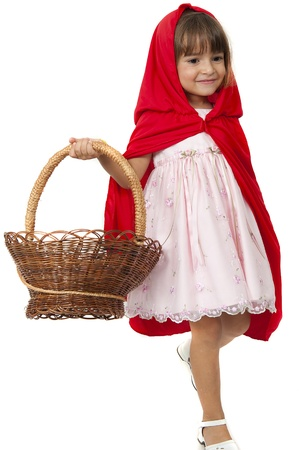 kids costume: little girl walking holding a basket using a red cape
