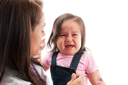 Adult woman care an Asian girl crying photo