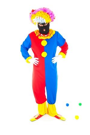 saboteur: Clown using an Terrorist mask on white background . Stock Photo