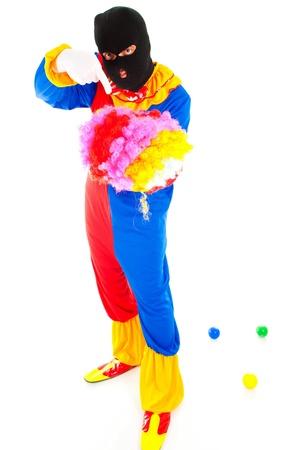 saboteur: Clown using an Terrorist mask and holding a wig