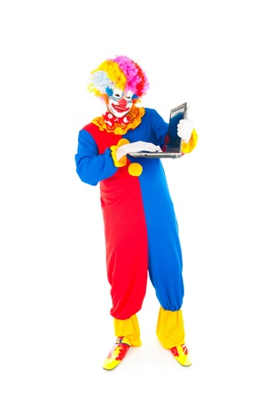 Adult Clown using a laptop on white . Stock Photo - 9541919