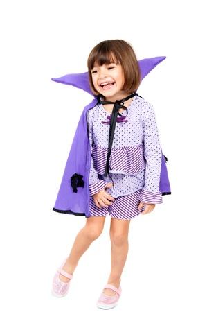 Cute girl with a vampire costume cloak . photo