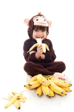 Kind mit Affen essen Bananen-Kostüm Standard-Bild