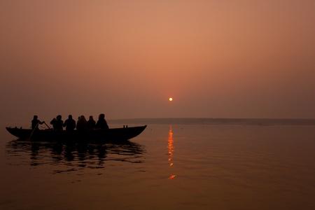 ganges: Sunset in the Ganges river, Varanasi - India .