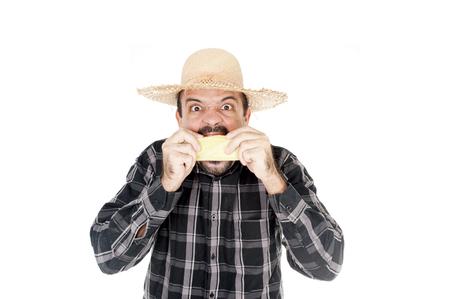 Man eating corn in saint john holiday photo