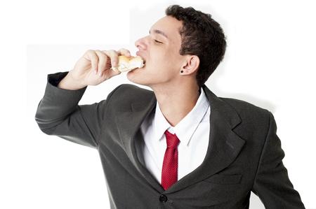 comiendo pan: El hombre de negocios joven con hambre de pan comer Foto de archivo