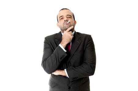 Face of a Serious Business man smoking photo