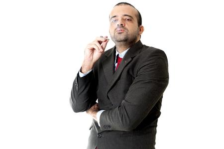 hombre fumando: Cara de un hombre de negocios serio fumar Foto de archivo
