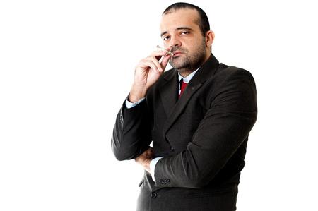 hombre fumando puro: Cara de un hombre de negocios serio fumar Foto de archivo