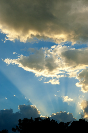 rises: Beautiful blue sky with clouds and sun rises Stock Photo