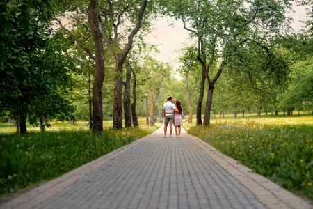 walking paths: Family love couple in the forest park on a Fairy tale road Stock Photo