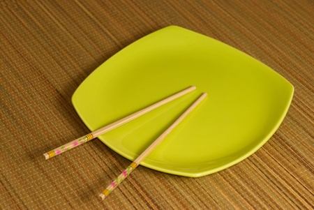 Chopsticks in the square plate photo