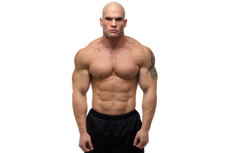 Bodybuilder posing in front of white background Stock Photo