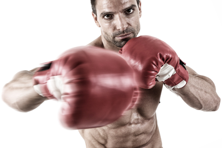 Muscular fighter punching in front of white background