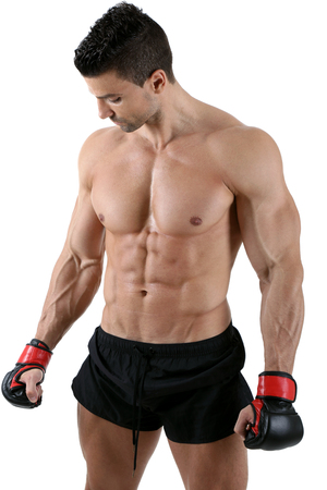 Powerful fighter standing in front of white background