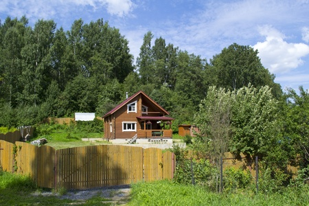 cladding tile: Wooden dacha in Russia Stock Photo