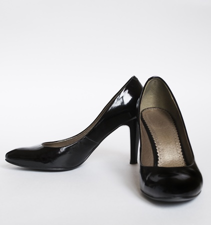 shinny black leather women shoes on gray background