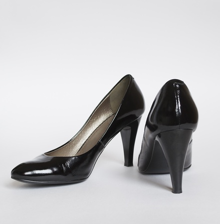 patent leather: shinny black leather women shoes on gray background