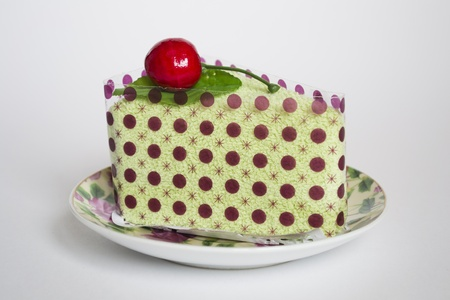 pressed towel in the form of cake on grey background Stock Photo - 12963029