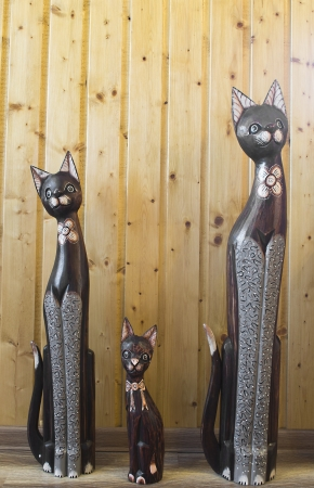 statues of cats family in interior