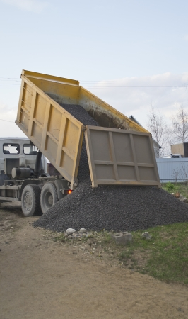 A dump truck dropping off a load. Stock Photo - 13774380
