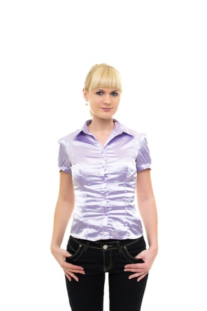 Young woman in blouse and jeans with hands in the pockets photo