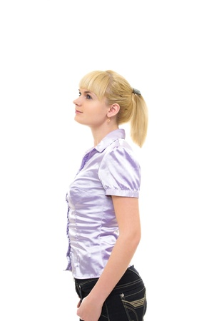 Young woman in blouse and jeans with hands in the pockets Stock Photo - 18290279