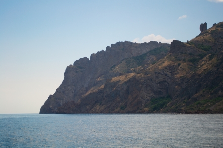 The view on Karadag rock  reserve on place of ancient extinct volcano  from the side of a excursion ship  Сrimea, Ukraine   photo