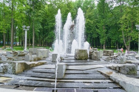 Fountain with stone hand in the middle in a park of Minsk city, Belarus
