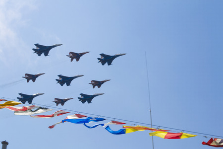 Russian military airplanes is flying away in blue sky