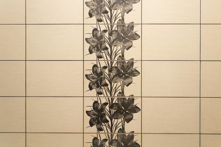 Beige tile with black lilies as background
