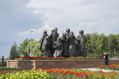 sculptural: the sculptural composition consisting of soldiers, their wives and children, sending them to war in Victory square of Vitebsk city, Belarus Stock Photo