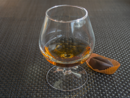 Cognac with chocolate in form of lips Stock Photo