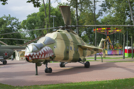 military helicopter with a threatening paiting-grin in the park of Vitebsk, Belarus