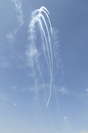 Russian military airplanes are drawing image in blue sky Stock Photo