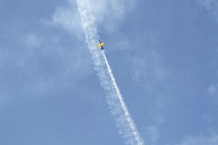 Russian military airplane is flying away in blue sky