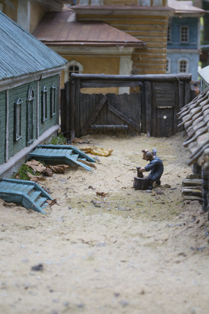 Smolensk, Russia - September 02, 2013 - Scene of rural life: a man is chopping wood Stock Photo