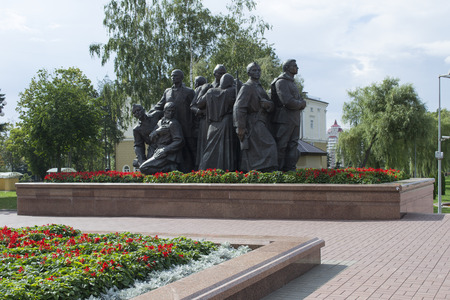 compostion: the sculptural composition consisting of soldiers, their wives and children, sending them to war in Victory square of Vitebsk city, Belarus Stock Photo