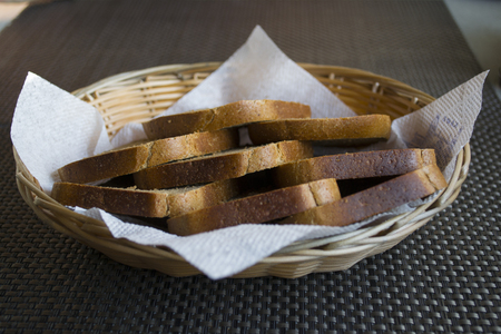 Cut loaf of brown bread Stock Photo
