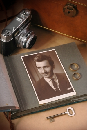 Conceptual photo of memories, with old photo of man with objects from past Stock Photo