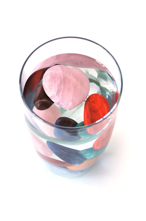 Crystal elixir � various kinds of crystal in full glass of water, making elixir, top view Stock Photo - 23184239