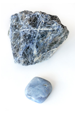Rough and smooth, processed and unprocessed, blue crystals Chalcedony and Sodalite on  white background