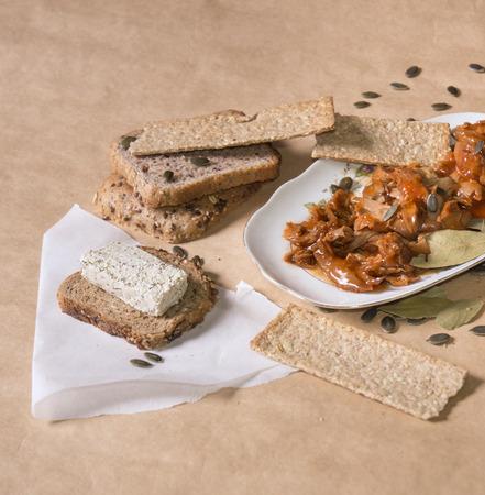 daub: Tuna fish meal in tomato sauce with tofu cheese daub, bread and oat tiles