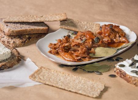 daub: Tuna fish meal in tomato sauce with oat tiles, pumpkin seed, bread and tofu daub Stock Photo