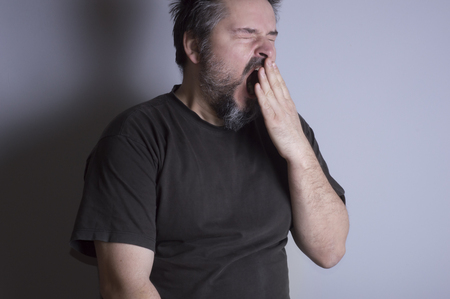 wakening: Sleepy man with beard, yawn