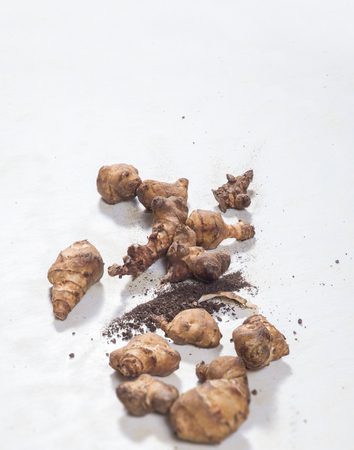 jerusalem artichoke: Raw Jerusalem artichoke on white table with copy space