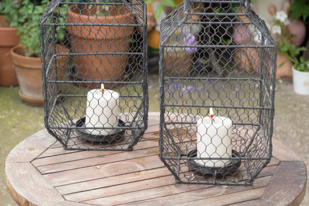 two candles in cages as decorative details
