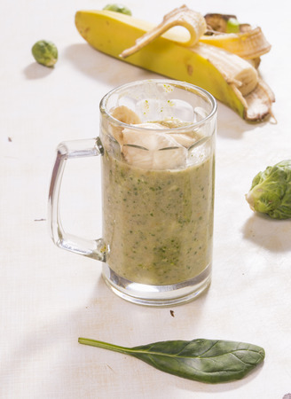 Glass of smoothie with broccoli banana and mint leaves Stock Photo
